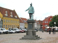 Statue of the Danish King ʺFrederik VII of Denmarkʺ at the square ʺTorvetʺ in the town ʺKøgeʺ