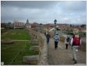 Crossing over the medieval bridge in Hospital and Puente de Orbigo