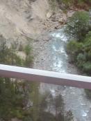højt oppe over en bjergflod/soaring high above a mountain river