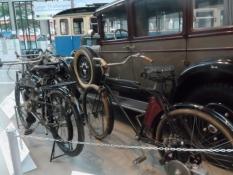 Fra trafikmuseet, her en Adler bil og en Opel cykel med hjælpemotor/At the traffic museum