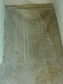 Rester af en romersk mosaik under kirkegulvet/Remains of a Roman mosaic beneath the floor