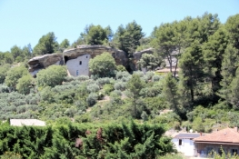 House built into a rock in Beaumettes