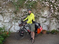 Man and bicycle are ready for two weeks of biking holiday