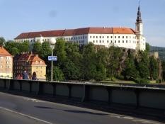 The palace of Děčín as seen from the bridge across the river