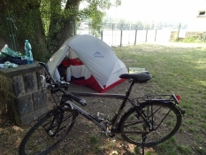 My friend Kolyaʹs bike and tent, pitched right down by the riverside