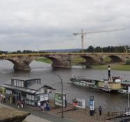 The Augustus bridge (under repair) spans the Elbe with a steamer
