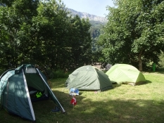 Our three small tents at the campsite of Sumvitg Cumpadials