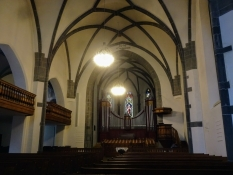 The interior of the church is sombre and simple